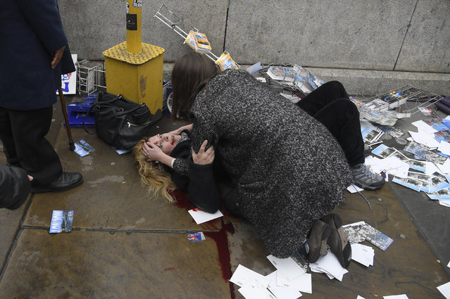 A woman lies injured after an incident on Westminster Bridge in London on Wednesday, March 22, 2017. (Photo by Toby Melville/Reuters)