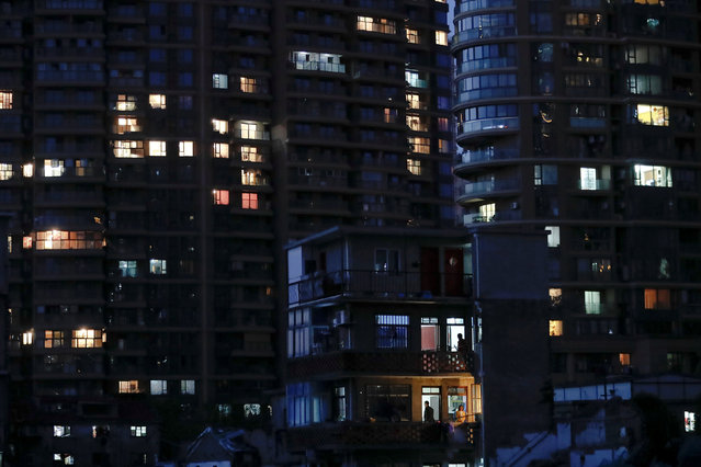 An old house is seen in front of new apartment buildings in Guangfuli neighbourhood, in Shanghai, China, April 18, 2016. (Photo by Aly Song/Reuters)