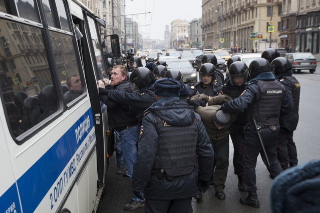 Police officers detain people in the main street in Moscow, Russia, Sunday, April 2, 2017. Russian prosecutors have moved to block calls on social networks ahead of street protests in Moscow and other Russian cities following a wave of rallies. (Photo by Pavel Golovkin/AP Photo)