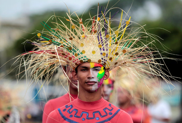 """A reveller takes part in an annual carnival called """"Alegria por la Vida"""" (Joy for life) in Managua, Nicaragua May 7, 2016. (Photo by Oswaldo Rivas/Reuters)"""