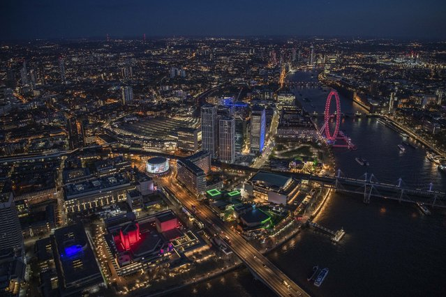 Night aerial view of SouthBank and the River Thames, London. (Photo by Jason Hawkes/Caters News Agency)