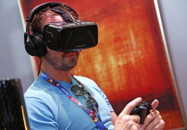 A man uses the Oculus Rift virtual reality headset at the 2014 Electronic Entertainment Expo, known as E3, in Los Angeles, June 10, 2014.  REUTERS/Jonathan Alcorn