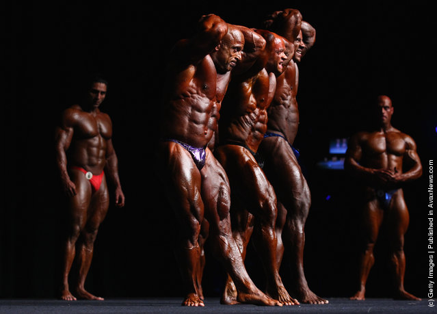 Competitors pose during pre judging for the 2012 IFBB Australian Pro Grand Prix XII at The Plenary