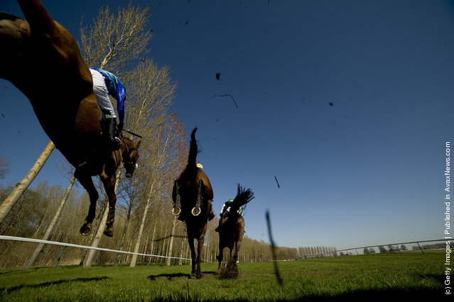 Charlie Poste riding Tooka (R) on their way to winning The ladbrokes.com Handicap Steeple Chase at Towcester racecourse