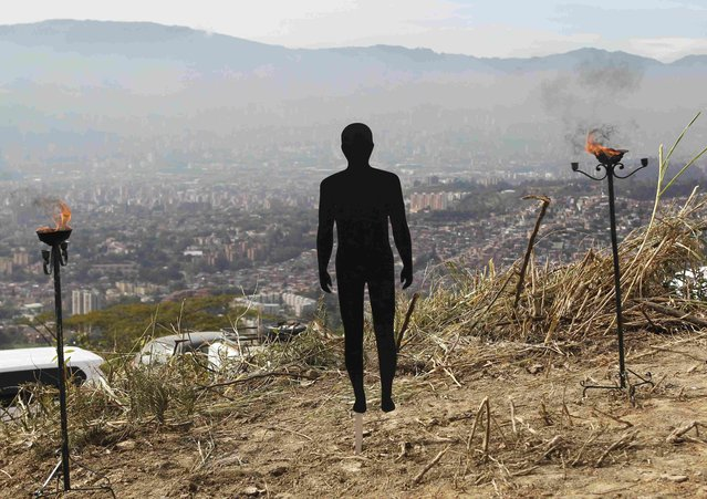 "A figure symbolizing missing people is pictured during a ceremony at ""La Escombrera"" rubbish dump in Medellin, Colombia July 27, 2015.  Colombian authorities began on Monday to unearth what they say is the world's largest urban mass grave, located in the garbage tip in a sprawling mountainside slum known as Comuna 13 in western Medellin. (Photo by Fredy Builes/Reuters)"