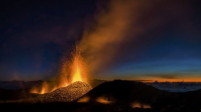 Molten lava erupts from the Piton de la Fournaise, one of the world's most active volcanoes, in this picture taken August 1, 2015, on the French Indian Ocean Reunion Island. The volcano erupted on Friday, opening up a 800-metre-long crack in its crater and sending hot jets of molten lava spewing up from the peak. (Photo by Gilles Adt/Reuters)
