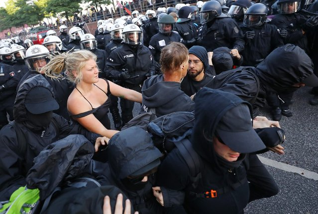 German riot police confront protesters during the demonstrations at the G20 summit in Hamburg, Germany, July 6, 2017. (Photo by Kai Pfaffenbach/Reuters)