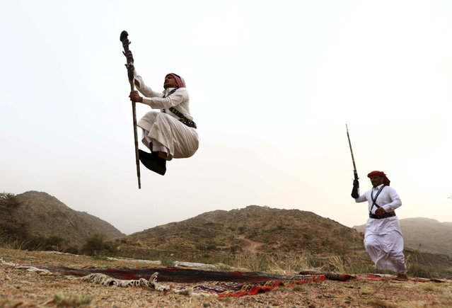 Men dance during a traditional excursion near the western Saudi city of Taif, August 8, 2015. (Photo by Mohamed Al Hwaity/Reuters)