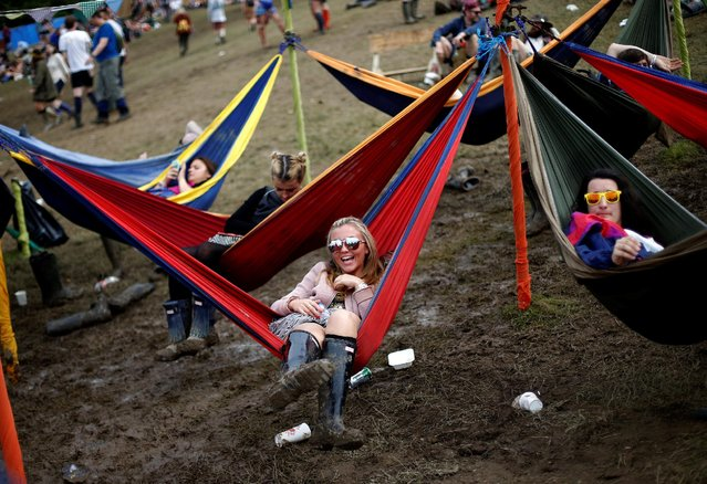 Revellers lie in hammocks during the Glastonbury Festival at Worthy Farm in Somerset, Britain, June 23, 2016. (Photo by Stoyan Nenov/Reuters)