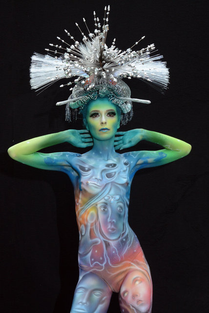 A model poses with her bodypainting designed by bodypainting artist Flavio Bosco from Italy, in the 2016 World Bodypainting Festival, 2016 in Poertschach am Woerthersee, Austria. (Photo by Didier Messens/Getty Images)