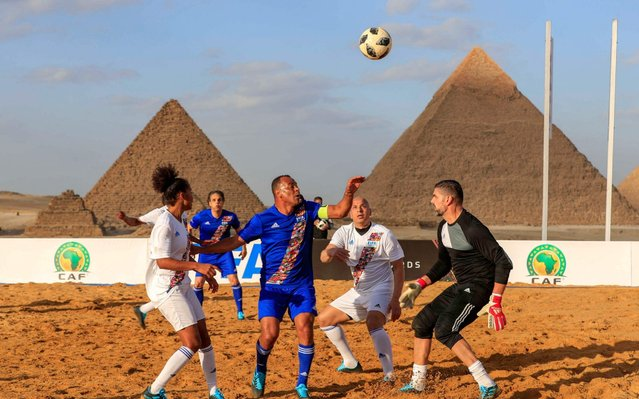 Brazilian footballer Denilson (C) and French football player Laura Georges (L) vie for the ball during the CAF and FIFA Legends football match, part of the CAF celebration of the best players in Africa, at the Giza pyramids plateau on the southwestern outskirts of the Egyptian capital Cairo on January 6, 2020. (Photo by Khaled Desouki/AFP Photo)