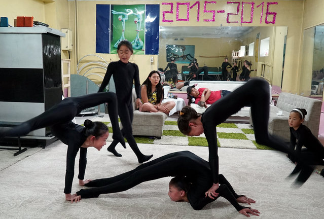 Young contortionists practice at a training school in Ulaanbaatar, Mongolia, July 4, 2016. (Photo by Natalie Thomas/Reuters)