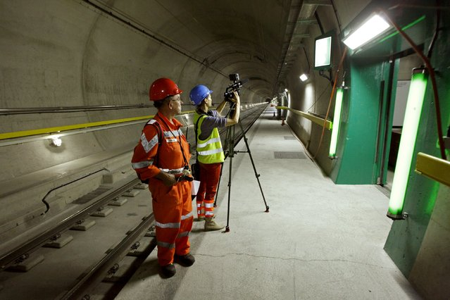 A TV camerawoman takes footages of an emergency exit at a multifunction and emergency stop station of the NEAT Gotthard Base Tunnel during a media visit near the town of Sedrun August 24, 2015. (Photo by Arnd Wiegmann/Reuters)