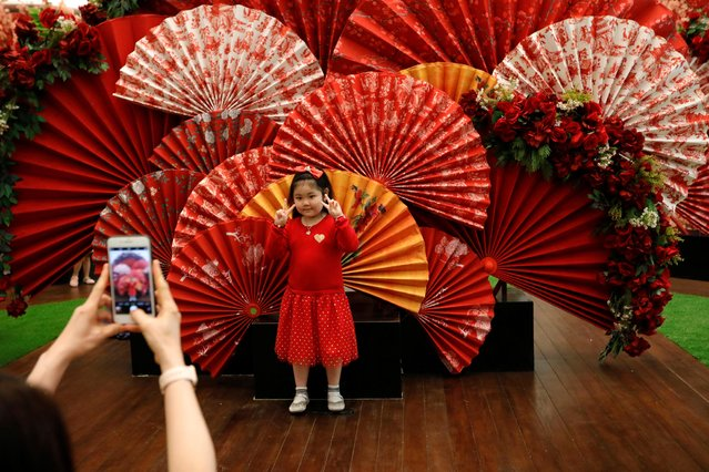 A girl poses for pictures near Lunar New Year decoration at a shopping mall in Jakarta, Indonesia, January 24, 2020. (Photo by Willy Kurniawan/Reuters)