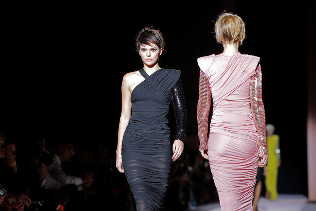 Models Kendall Jenner and Gigi Hadid present a creations from the Tom Ford Spring/Summer 2018 collection at New York Fashion Week in Manhattan, New York, U.S., September 6, 2017. (Photo by Andrew Kelly/Reuters)