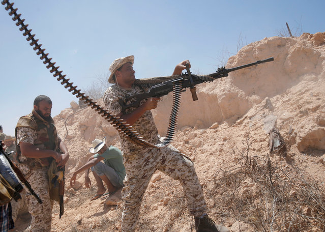 A fighter of Libyan forces allied with the U.N.-backed government fires a weapon during a battle with IS fighters in Sirte, Libya, July 21, 2016. (Photo by Goran Tomasevic/Reuters)