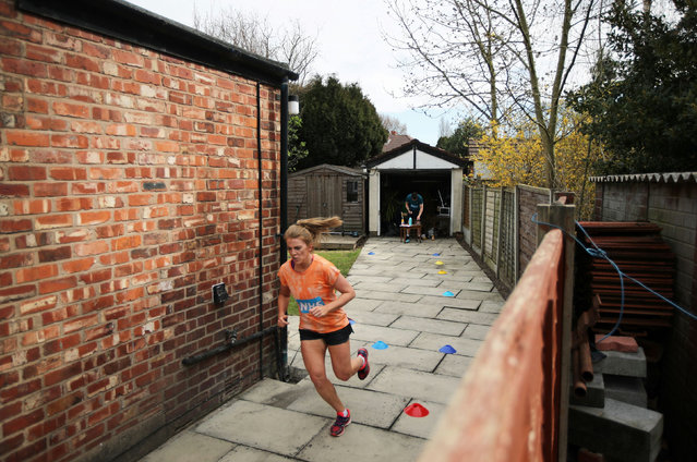 Cloda Lowden runs a marathon in her garden raising money for NHS, as the spread of the coronavirus disease (COVID-19) continues, Manchester, Britain, April 5, 2020. (Photo by Molly Darlington/Reuters)