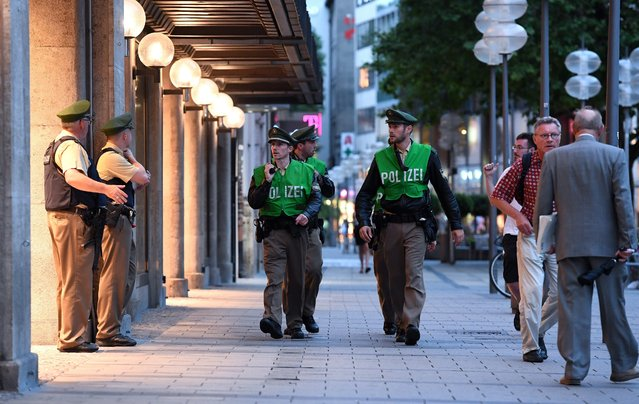 Policemen patrol the pedestrian zone after a shootout in Munich, Germany, 22 July 2016. After a shootout in the Olympia shopping centre (OEZ), the police reported severa injuries and possible deaths. (Photo by Sven Hoppe/EPA)