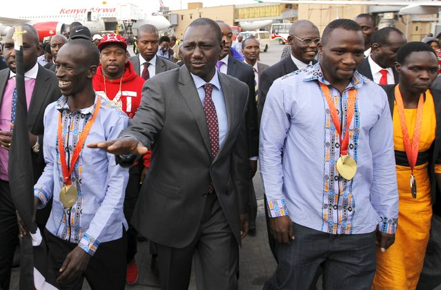 Kenya's Deputy President William Ruto (C) welcomes the national athletics team at the Jomo Kenyatta airport in Nairobi, September 1, 2015, after they topped the medals table at the recently concluded 15th International Association of Athletics Federations (IAAF) World Championships at the National Stadium in Beijing, China. (Photo by Thomas Mukoya/Reuters)
