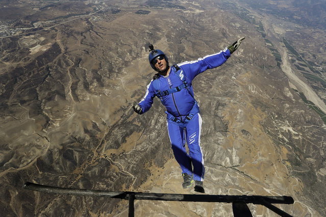In this Monday, July 25, 2016 photo, skydiver Luke Aikins jumps from a helicopter during his training in Simi Valley, Calif. (Photo by Jae C. Hong/AP Photo)