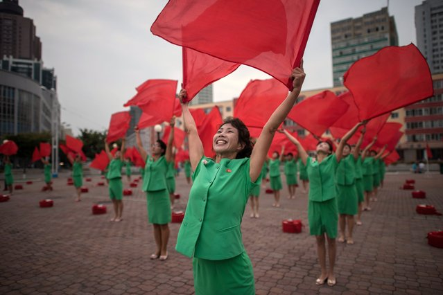 A propaganda troupe perform a flag- waving routine outside the central railway station in Pyongyang, North Korea on September 27, 2017. (Photo by Ed Jones/AFP Photo)
