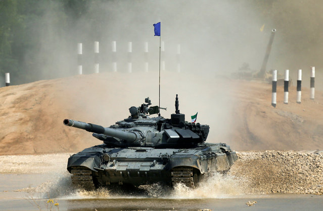 A T-72 tank, operated by a crew from Kuwait, drives during the Tank Biathlon competition, part of the International Army Games 2016, at a range in the settlement of Alabino outside Moscow, Russia, August 2, 2016. (Photo by Maxim Shemetov/Reuters)