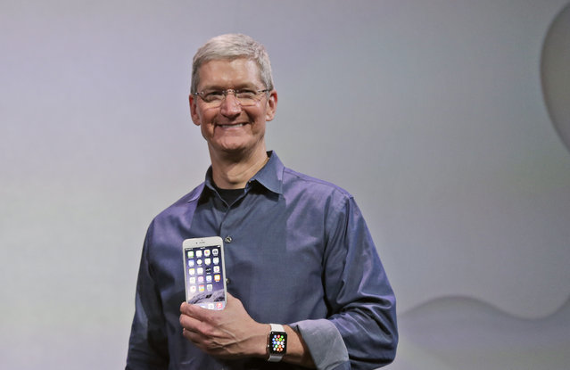 Apple CEO Tim Cook discusses the new Apple Watch and iPhone 6 on Tuesday, September 9, 2014, in Cupertino, Calif. (Photo by Marcio Jose Sanchez/AP Photo)