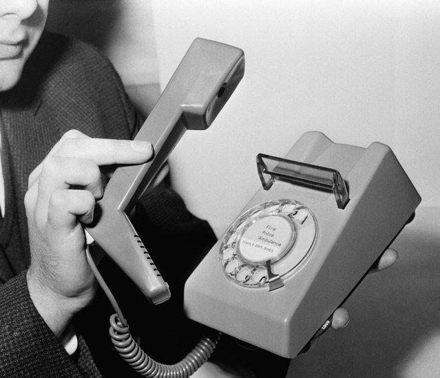 British telephone handset mounted lengthwise instead of horizontally on the base, pictured in London, May 26, 1966. The phone, which won the Design Center Award in 1966, also has a warbling tone as its ring, and a luminous dial. It is light weight and small enough to be carried in one hand. The phone is manufactured by Standard Telephones and Cables Ltd. (Photo by AP Photo)