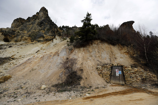 The entrance of a closed goldmine gallery is seen near Rosia Montana, central Romania, March 24, 2014. (Photo by Bogdan Cristel/Reuters)