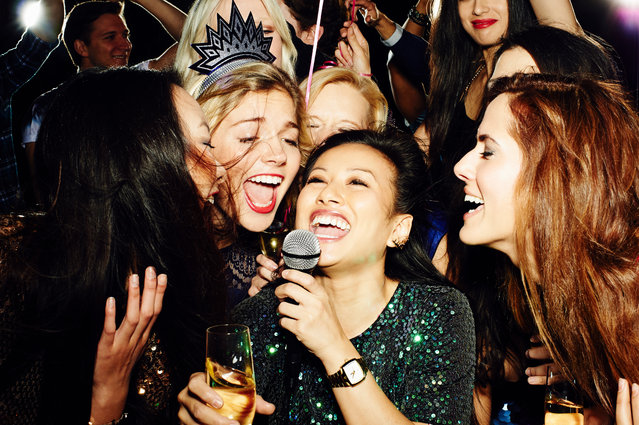 Group of friends having fun on night out. Karaoke. (Photo by Flashpop/Getty Images)