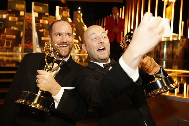Mark Paterson, left, and Tim Farrell pose backstage at the Television Academy's Creative Arts Emmy Awards at Microsoft Theater on Saturday, September 12, 2015, in Los Angeles. (Photo by Colin Young-Wolff/Invision for the Television Academy/AP Images)