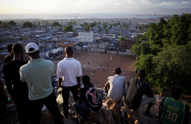 Residents attend a soccer match in a neighborhood in Port-au-Prince, Haiti, August 7, 2016. (Photo by Andres Martinez Casares/Reuters)