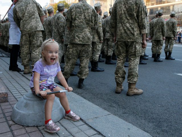A girl reacts during a rehearsal for the Independence Day military parade in central Kiev, Ukraine, August 19, 2016. (Photo by Valentyn Ogirenko/Reuters)