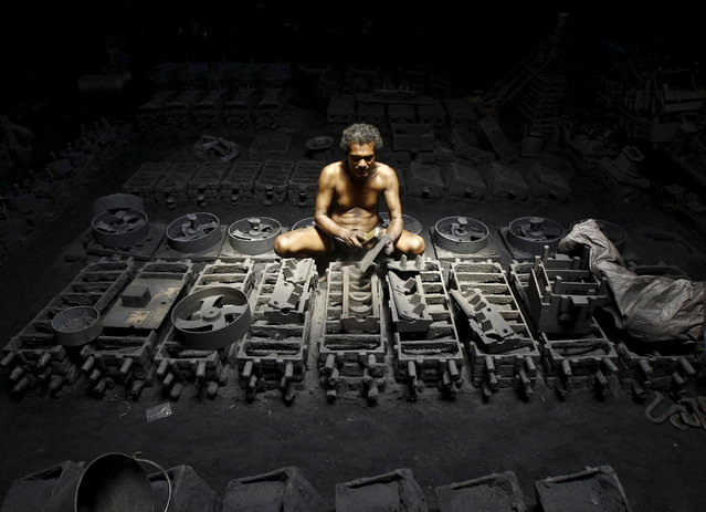 A labourer works inside the manufacturing unit of iron parts at a factory on the outskirts of Kolkata, September 11, 2015. India's annual industrial output growth slowed to 4.2 percent in July compared with an upwardly revised 4.4 percent growth a month ago, government data showed on Friday. (Photo by Rupak De Chowdhuri/Reuters)