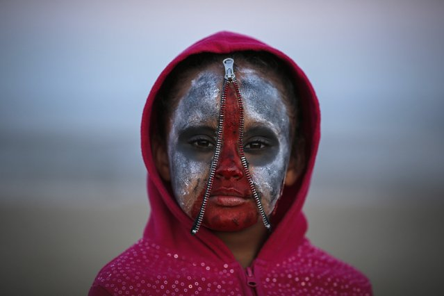 A child takes part in a Zombie Walk in Asbury Park, New Jersey October 4, 2014. (Photo by Eduardo Munoz/Reuters)