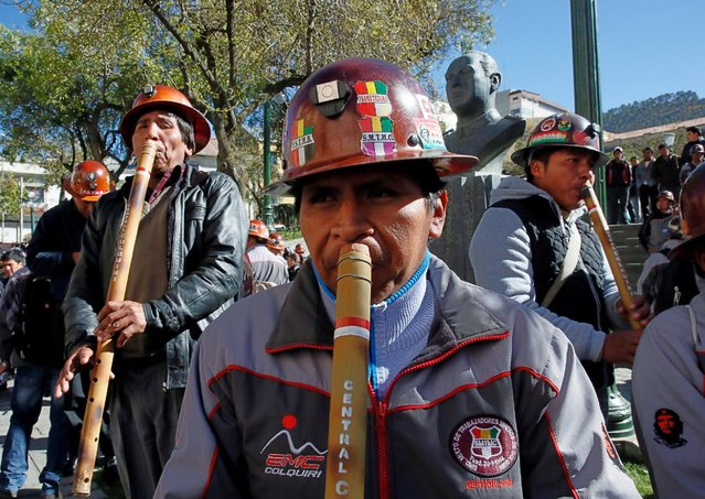 Mine workers from the Colquiri tin and silver mine play native instruments in front of the presidential palace after a ceremony in La Paz, Bolivia August 29, 2016. (Photo by David Mercado/Reuters)