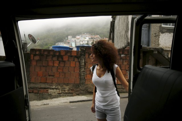 Tulin Hashemi, a Syrian, waits to enter a kombi to go home in Vidigal slum in Rio de Janeiro, Brazil, September 22, 2015. (Photo by Pilar Olivares/Reuters)