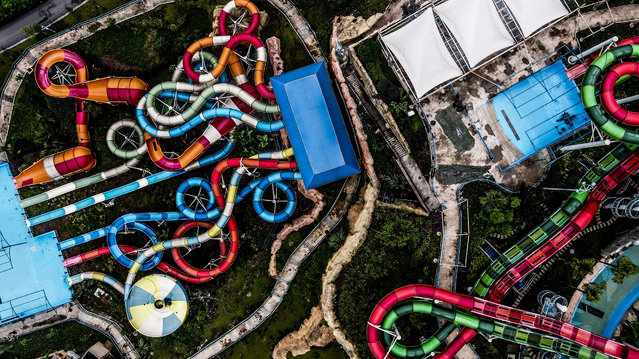 View on Chongqing's abandoned amusement park, China on June 28, 2020. Two years after it was abandoned, Chongqing's Mayan water world is to reopen, with an aerial ride resembling a fairy tale. (Photo by Sipa Asia/Rex Features/Shutterstock)