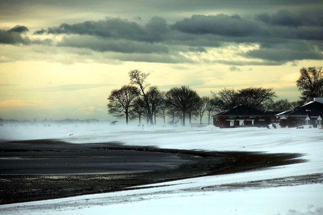 A windswept beach is desolate following a snow storm on December 27, 2010 in Westport, Connecticut. (Photo by Spencer Platt)