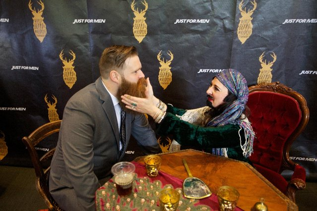 Attendee at the Just For Men World Beard and Moustache Championships getting his fortune told by a bearded mystic lady on Saturday, October 25, 2014 in Portland, OR. (Photo by Craig Mitchelldyer/AP Images for Just for Men)