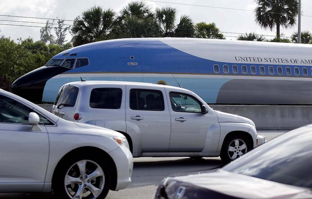 "A replica of Air Force One travels on a flatbed truck eastbound on Southern Blvd. to the South Florida Fairgrounds in West Palm Beach, January 9, 2013. The 65-foot by 12-foot fuselage replicates the Air Force One that was used for nearly three decades, from President John F. Kennedy through President Ronald Reagan. The South Florida Fair's Exposition Hall will take on a presidential look later in the month. A number of new attractions will be set up in the 70,000 square foot expo space with the theme, ""Washington, D.C., Our Nation's Capital"". (Photo by Allen Eyestone/The Palm Beach Post)"