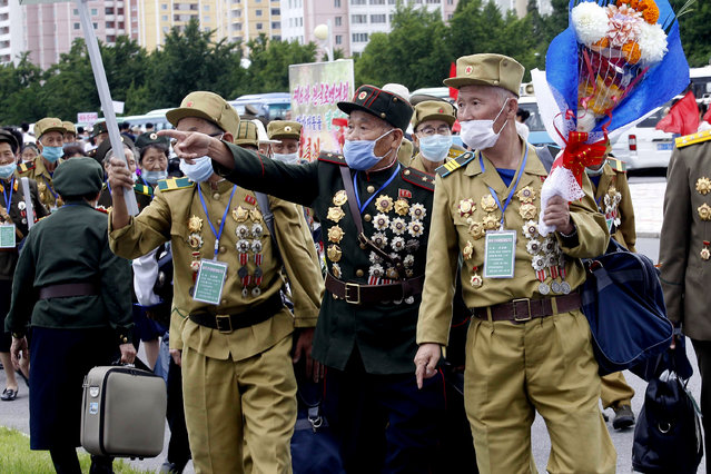 """War veterans head to a hotel to attend a national conference of war veterans on the occasion of the 67th anniversary of the end of the Korean War, which the country celebrates as the day of """"victory in the fatherland liberation war"""" in Pyongyang, North Korea, Saturday, July 25, 2020. (Photo by Jon Chol Jin/AP Photo)"""