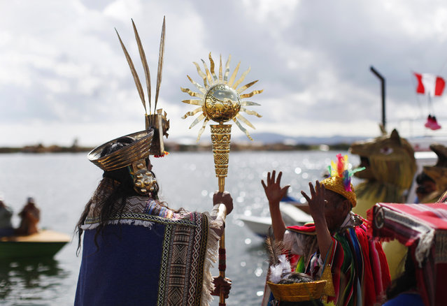 An Andean actor holds a golden staff during a re-enactment of the legend of Manco Capac and Mama Ocllo in a Uros island at Lake Titicaca in Puno November 5, 2014. (Photo by Enrique Castro-Mendivil/Reuters)