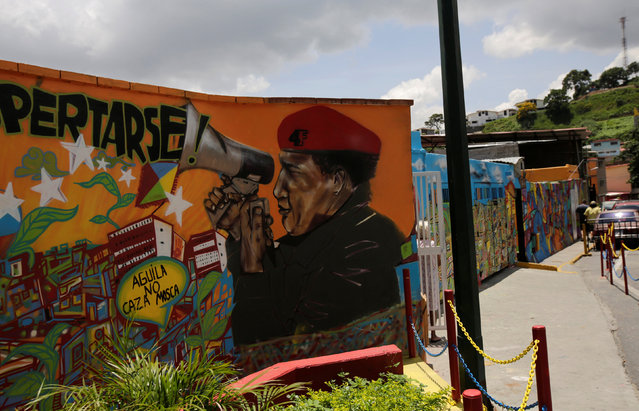 A mural of Venezuela's late president Hugo Chavez is seen along a street in Caracas, Venezuela September 10, 2016. (Photo by Henry Romero/Reuters)