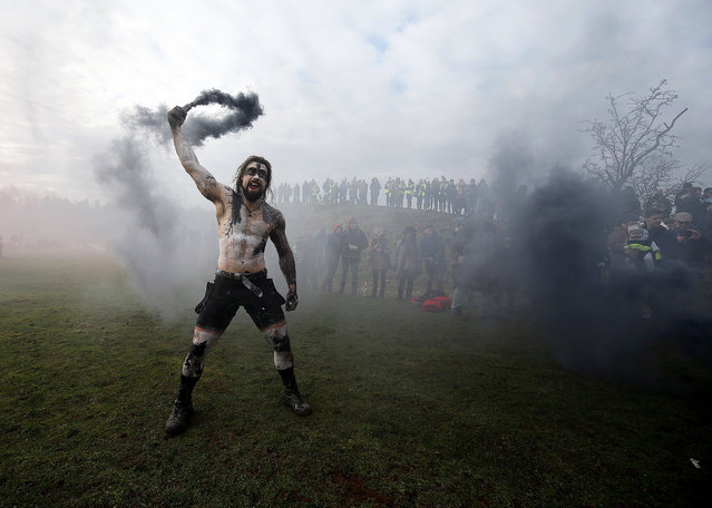 A competitor reacts ahead of Tough Guy Mudathon event in Perton, Britain, 04 February 2018. (Photo by  Nigel Roddis/EPA/EFE)