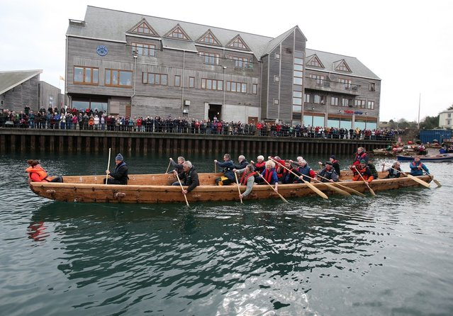 Crew in Britain's first ever full-size reconstructed sea-going Bronze Age boat, paddle out to sea near to the National Maritime Museum as it makes its maiden voyage on March 6, 2013 in Falmouth, England. Photo by Matt Cardy)