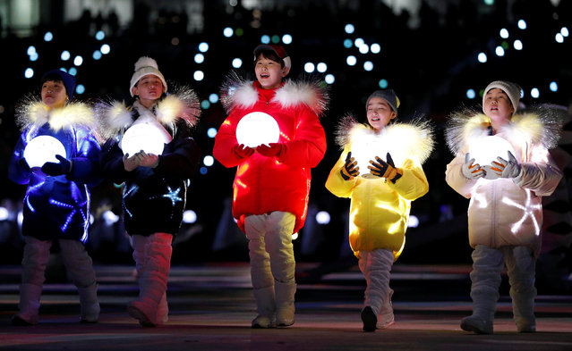 Volunteers participate in the closing ceremony of the PyeongChang Winter Olympic Games at the Olympic Stadium in Pyeongchang, South Korea, on February 25, 2018. (Photo by John Sibley/Reuters)