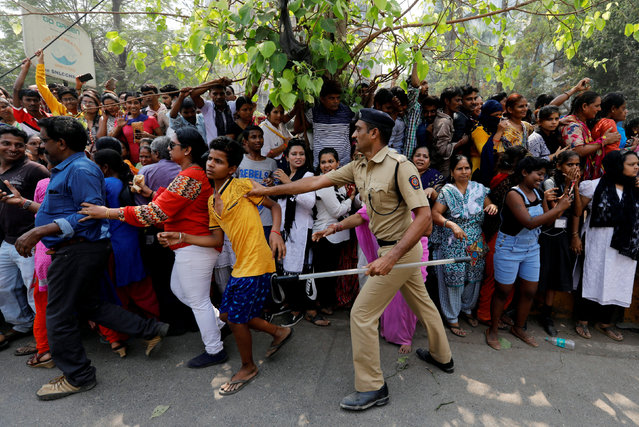 A fan of Bollywood actress Sridevi is pushed by a policeman as he waits with others to offer condolences outside a makeshift memorial in Mumbai, India February 28, 2018. (Photo by Danish Siddiqui/Reuters)