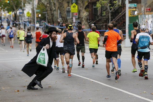 An Orthodox Jewish man tries to cross the street in the Williamsburg section of the Brooklyn borough during the 2015 New York City Marathon in New York, November 1, 2015. (Photo by Shannon Stapleton/Reuters)