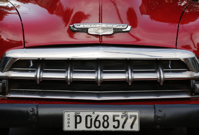 The detail of the front end of a recently painted 1952 Chevrolet sits parked in Havana, Cuba, Sunday, December 21, 2014. (Photo by Desmond Boylan/AP Photo)